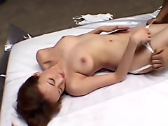 Cute Japanese babe with a hairy pussy in Extreme Bukkake orgy