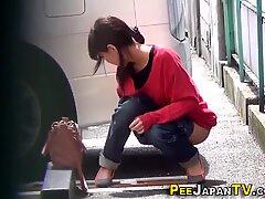 Asian pisses in public car park